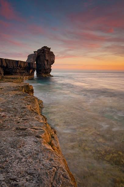 pulpit rock twilight - pulpit rock dorset stock photos and pictures