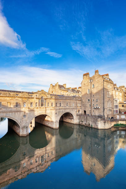 Pulteney Bridge and River Avon in Bath England UK Stock photograph of the landmark Pulteney Bridge above River Avon in Bath, England, United Kingdom. bath england stock pictures, royalty-free photos & images