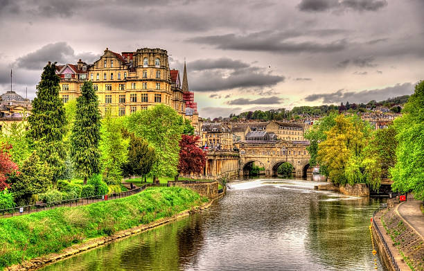 Pulteney Bridge over the River Avon in Bath, England View of Bath town over the River Avon - England bath england stock pictures, royalty-free photos & images