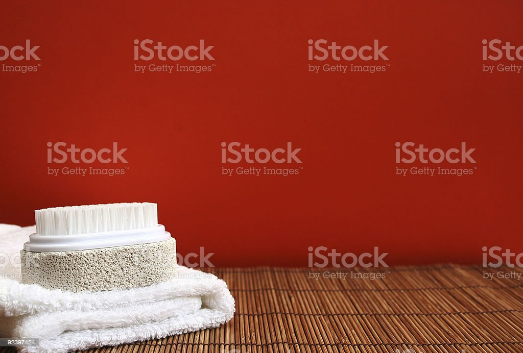 Pumice brush and towel at a spa - copy space royalty-free stock photo