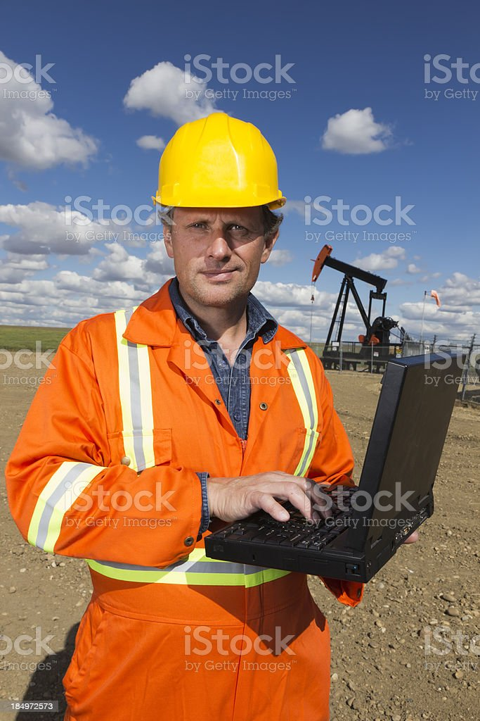 Pumjack, Oil Worker and Computer royalty-free stock photo