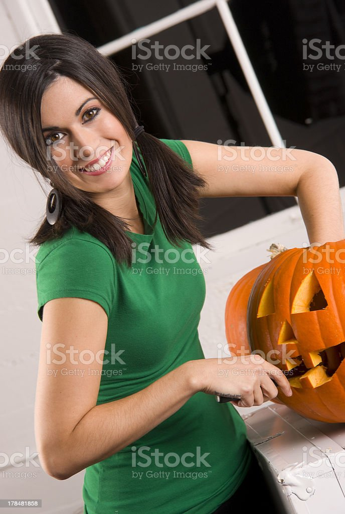 Pumkin Carving On Halloween By Attractive Home Maker royalty-free stock photo