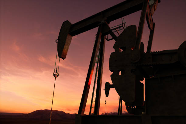 pump jack in an oil field 3D rendering of pump jack in an oil field saudi arabia stock pictures, royalty-free photos & images