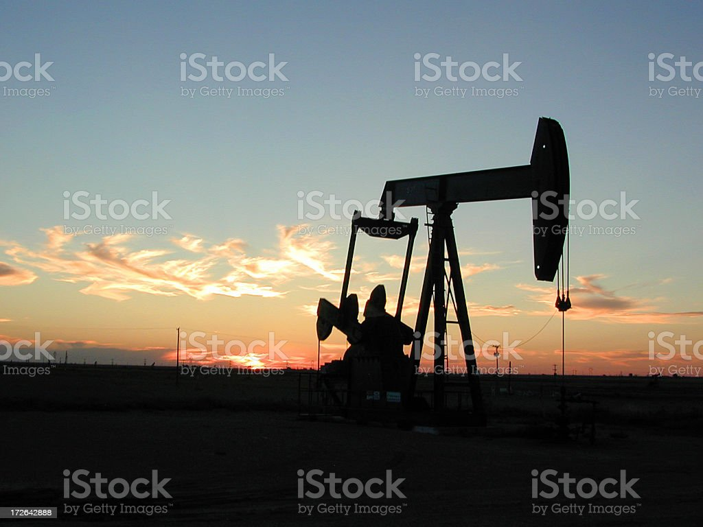Pump Jack in Texas at Sunset royalty-free stock photo