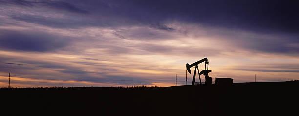 Pump Jack Panorama at Sunset stock photo