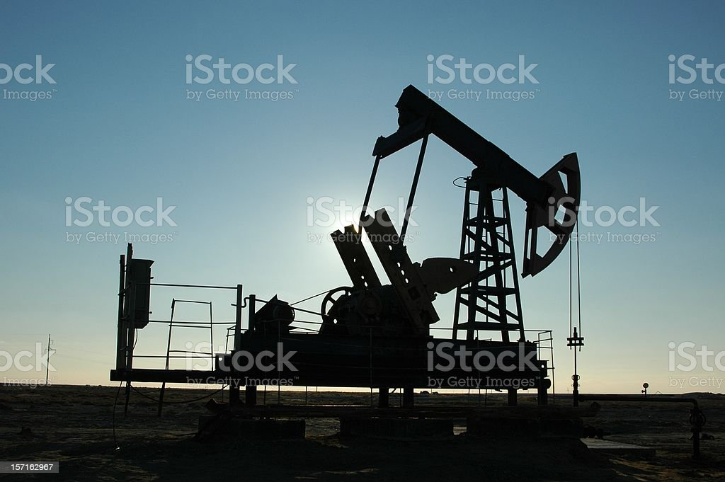 Pump jack silhouette royalty-free stock photo