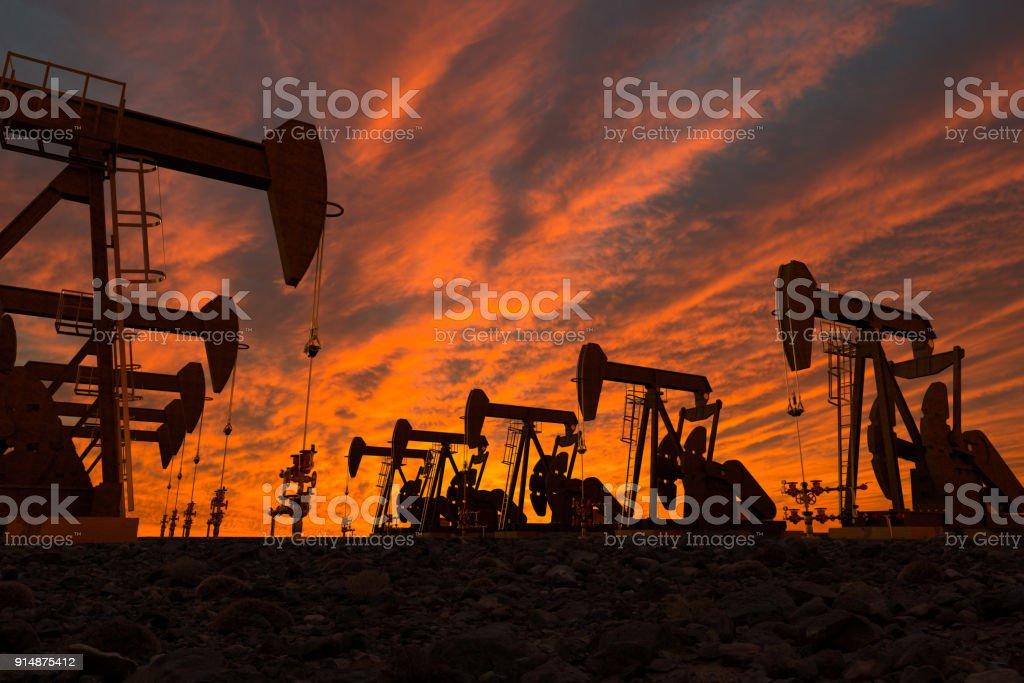 pump jacks in an oil field 3D render of pump jacks in an oil field Agricultural Field Stock Photo