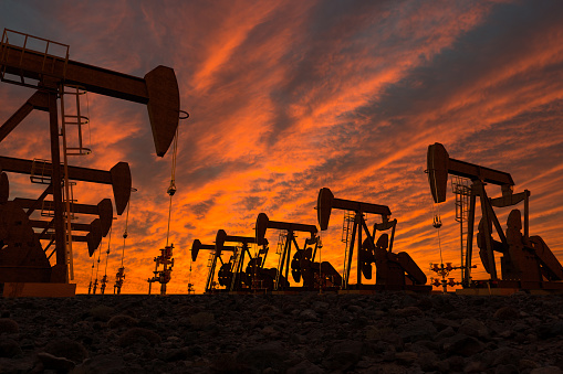 Pump Jacks In An Oil Field Stock Photo - Download Image Now
