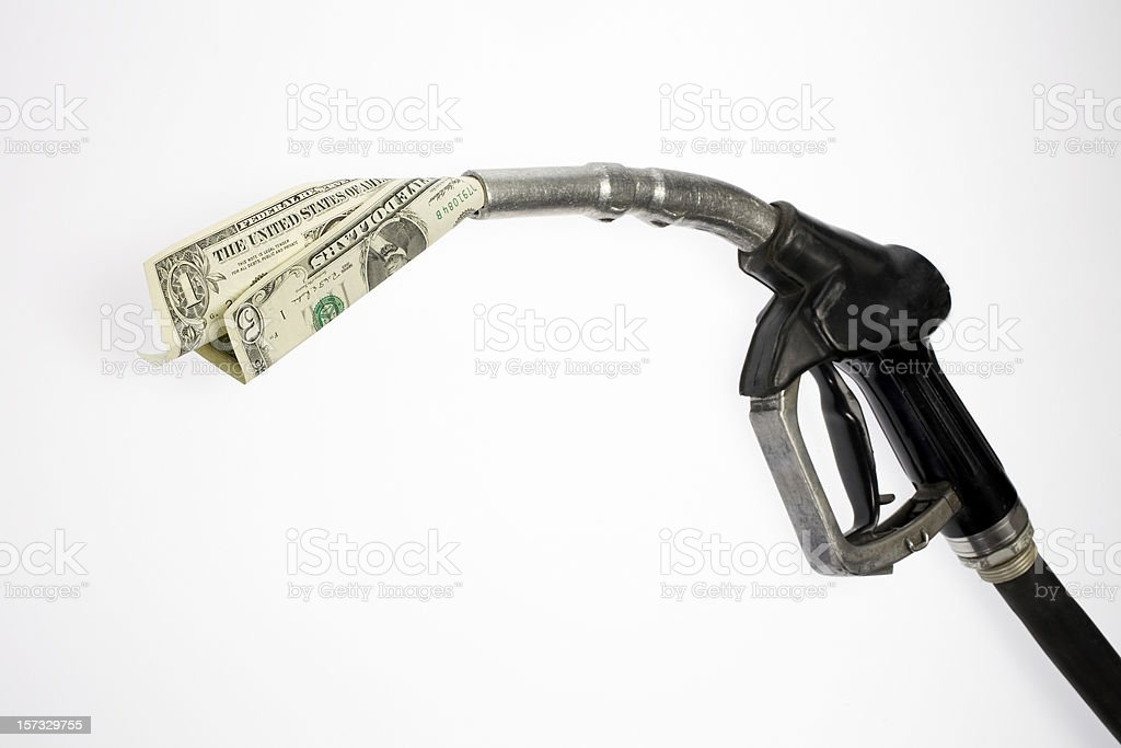 Pump nozzle sucking dollars stock photo