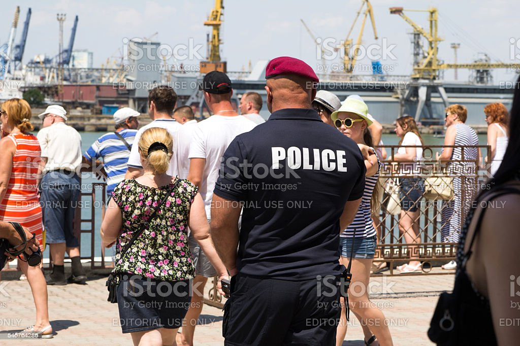 Odesa, Ukraine - July 03, 2016: Pumped policeman in red stock photo