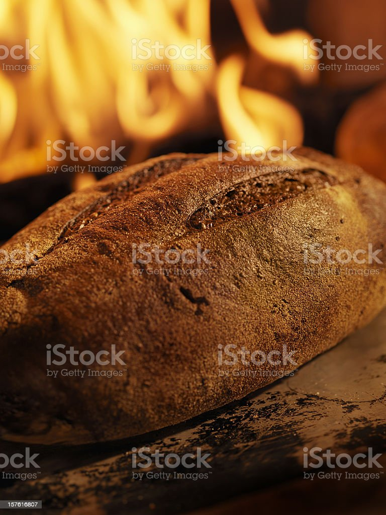 Pumpernickel Bread in a Wood Burning oven royalty-free stock photo