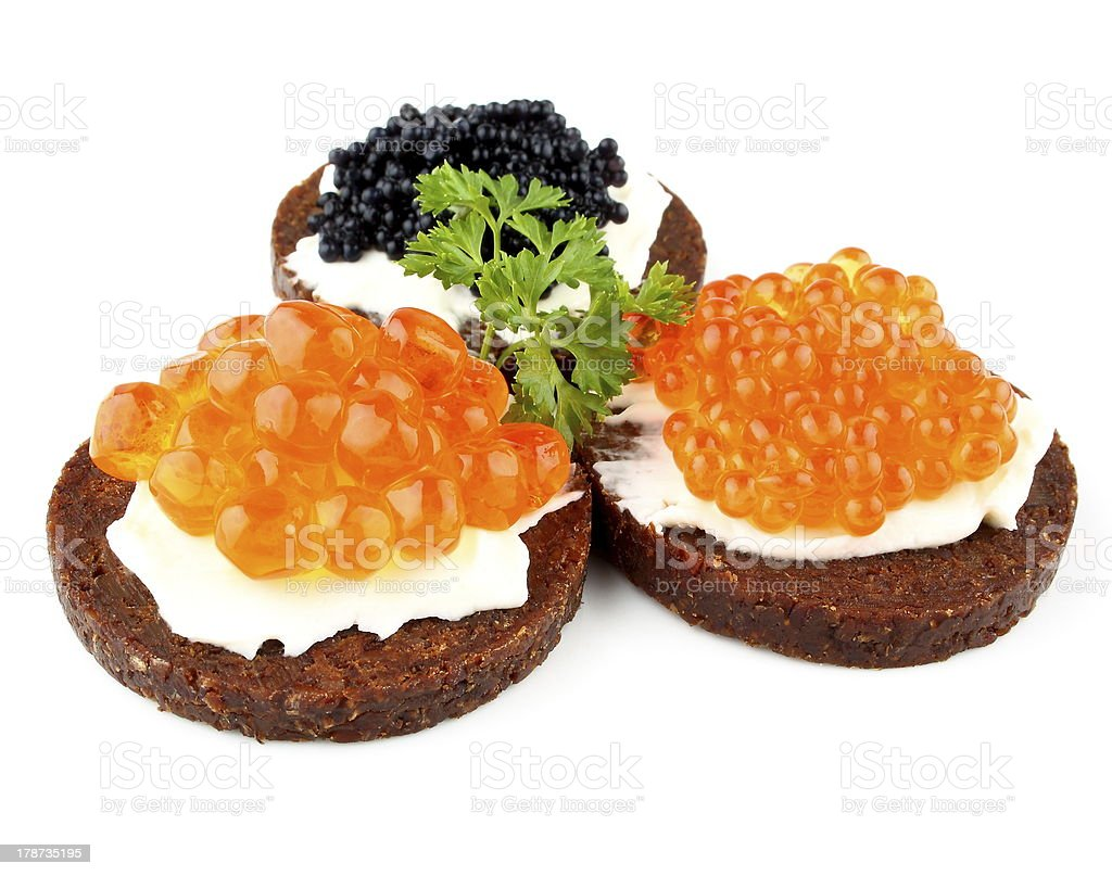 Pumpernickel bread with salmon, trout and sturgeon caviar stock photo