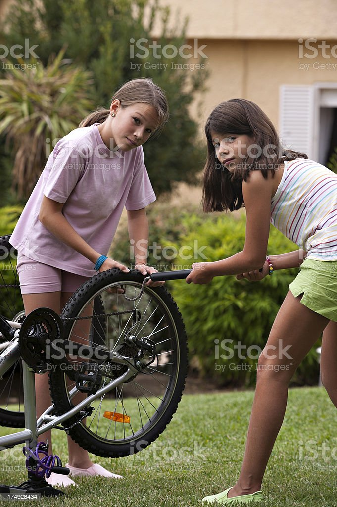 Pumping bicycle tire royalty-free stock photo