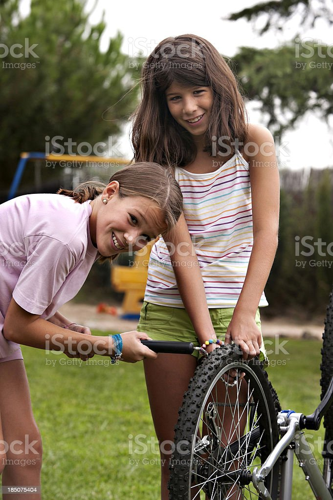 Pumping bicycle tire stock photo