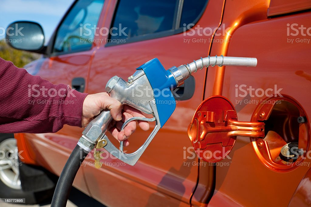 Pumping Gas Into Gas-Guzzler royalty-free stock photo