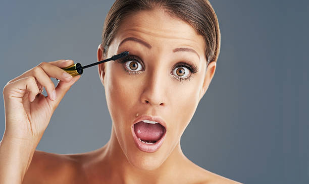 pumping up her lashes - omg stock photos and pictures