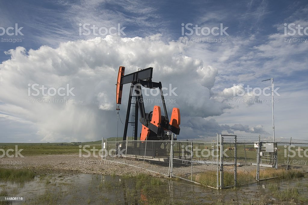 Pumpjack and a summer storm royalty-free stock photo