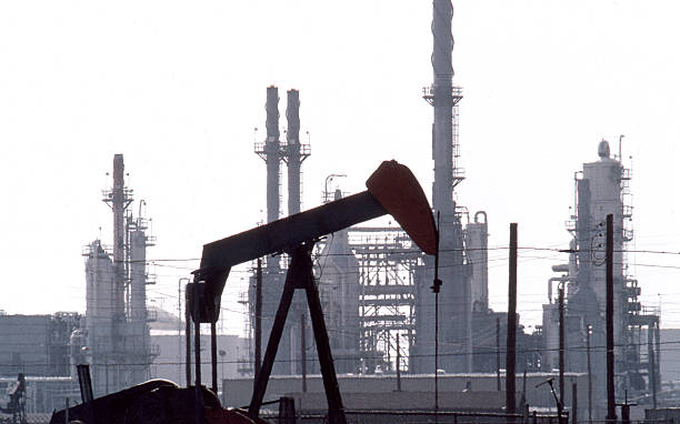 Pumpjack and Refinery stock photo