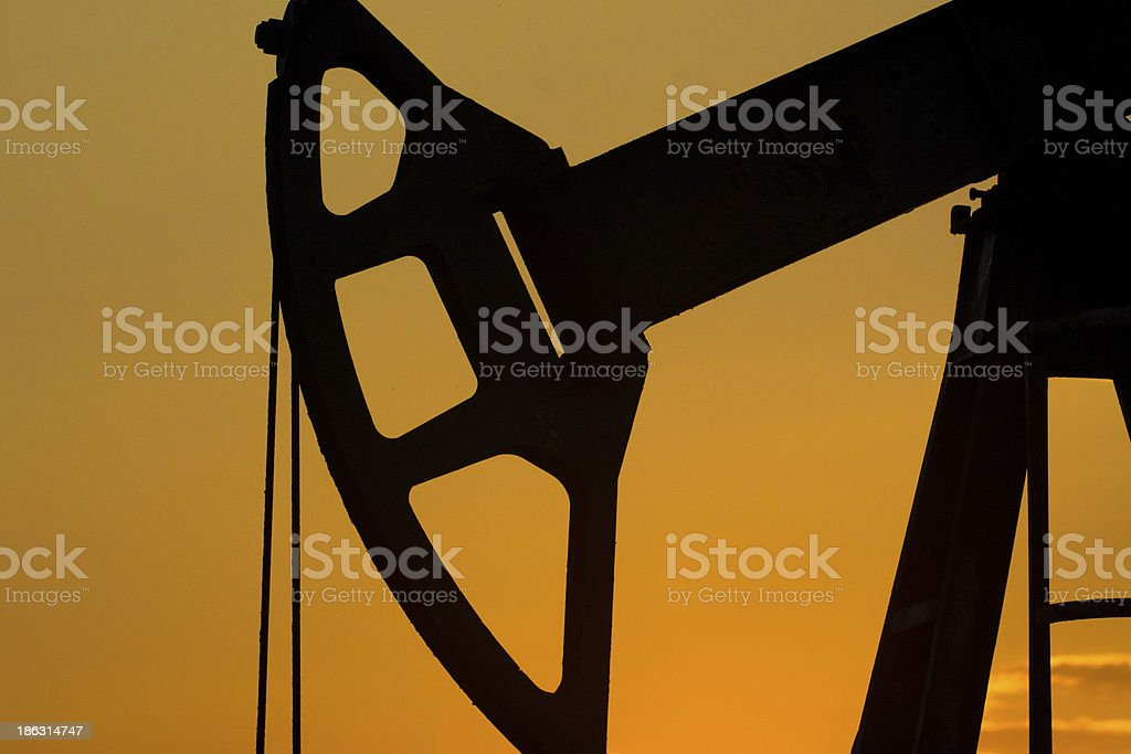 Pumpjack as the sunrises royalty-free stock photo