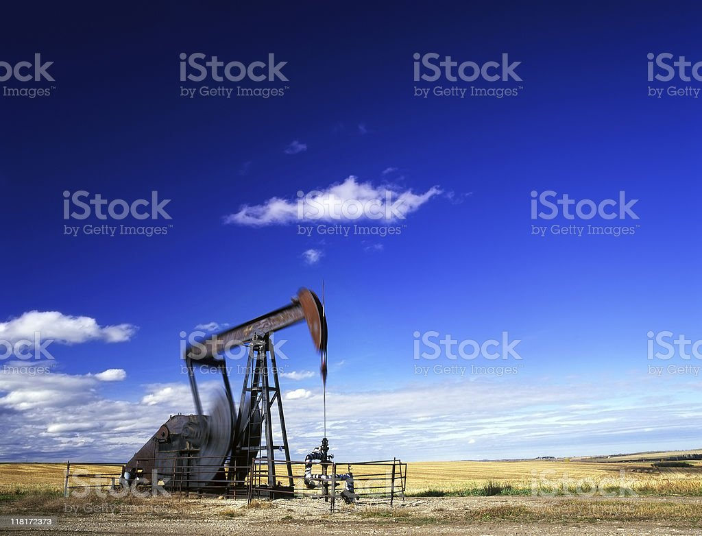Pumpjack in action stock photo