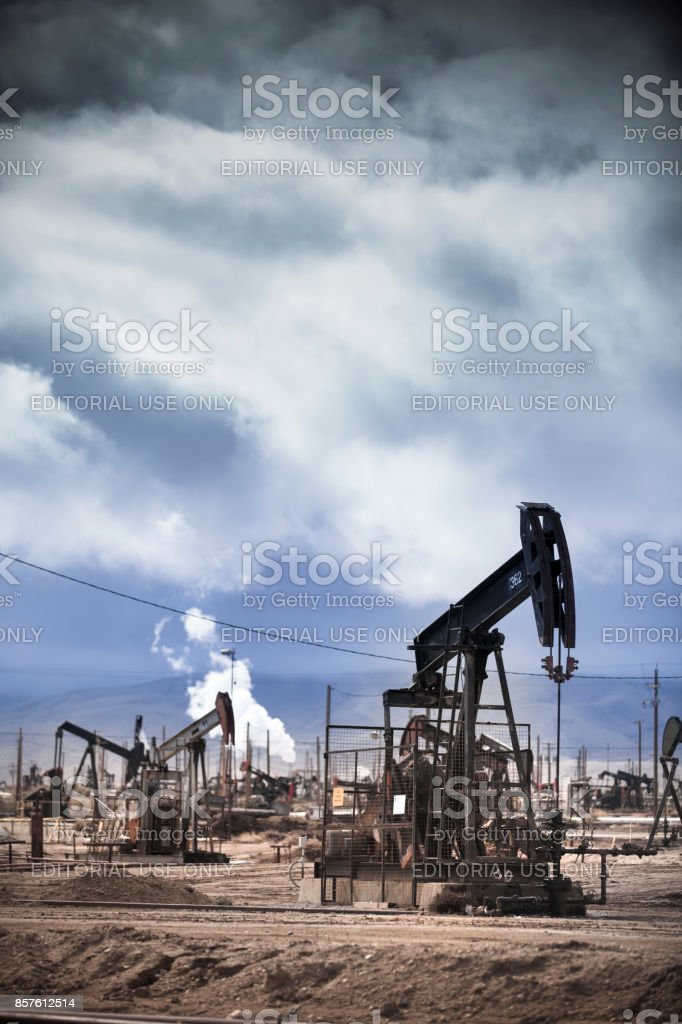 Pumpjack lifts oil from a well in California stock photo
