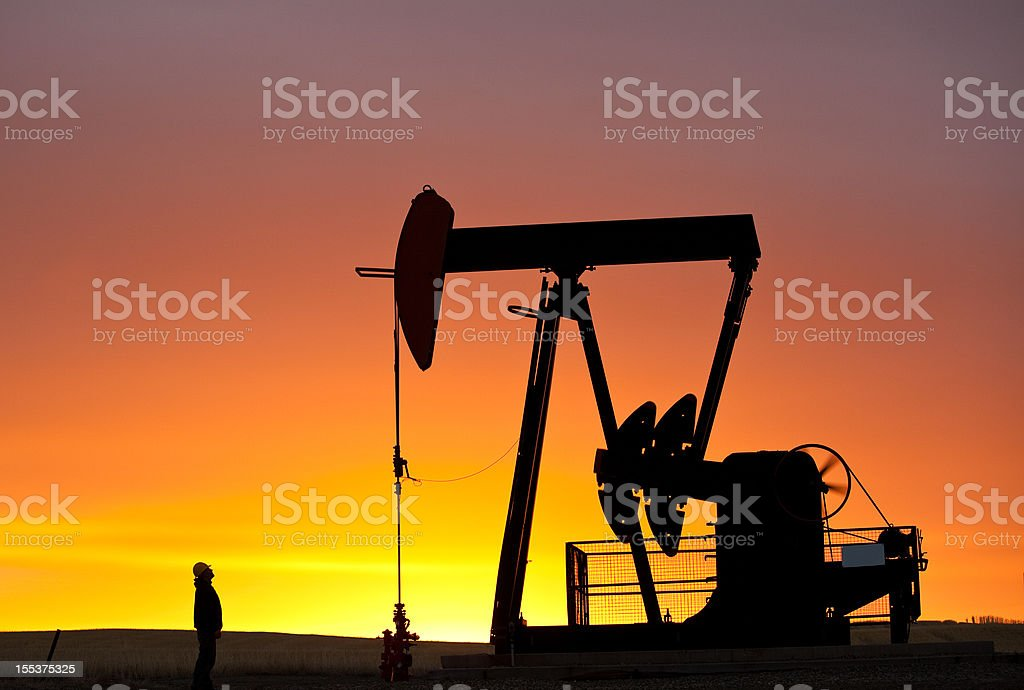 Pumpjack Silhouette With Worker royalty-free stock photo