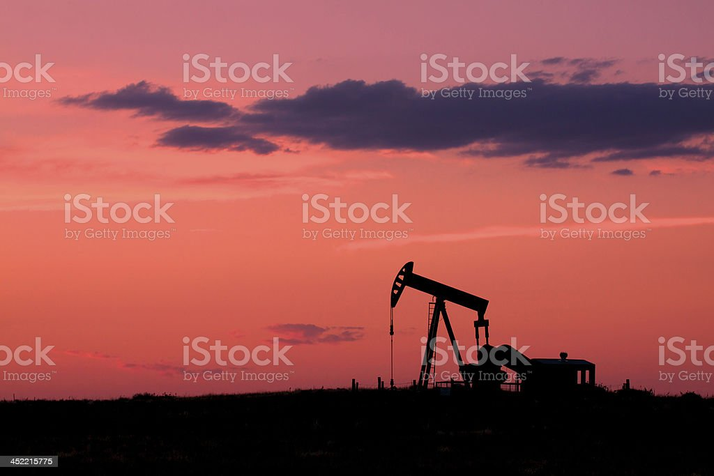 Pumpjack Silhouetted in Sunset royalty-free stock photo