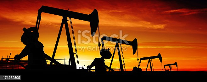 oil pumpjacks in silhouette at sunset, panoramic frame (XXXL)