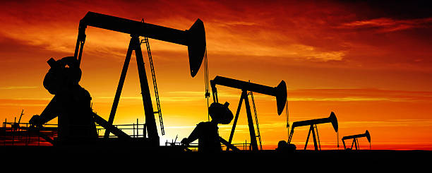 XXXL pumpjack silhouettes stock photo