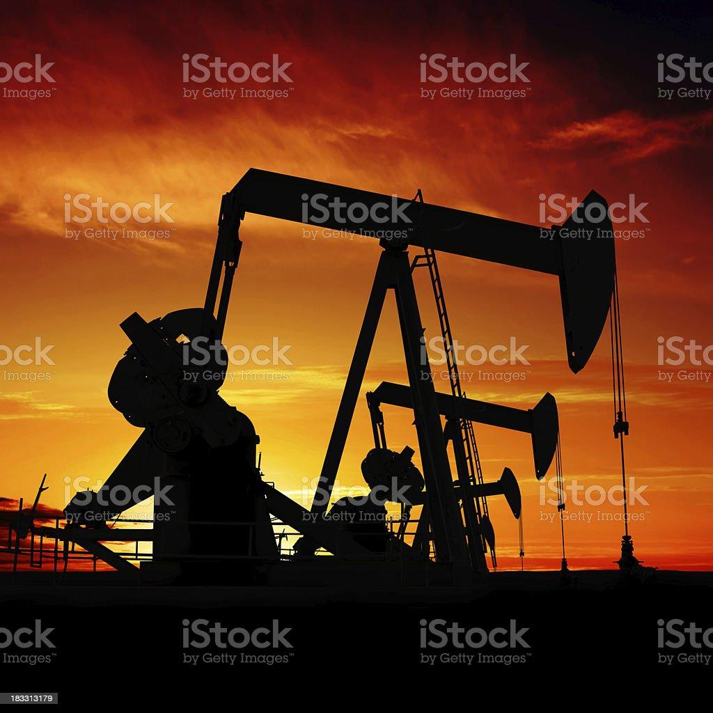 XXXL pumpjack silhouettes royalty-free stock photo