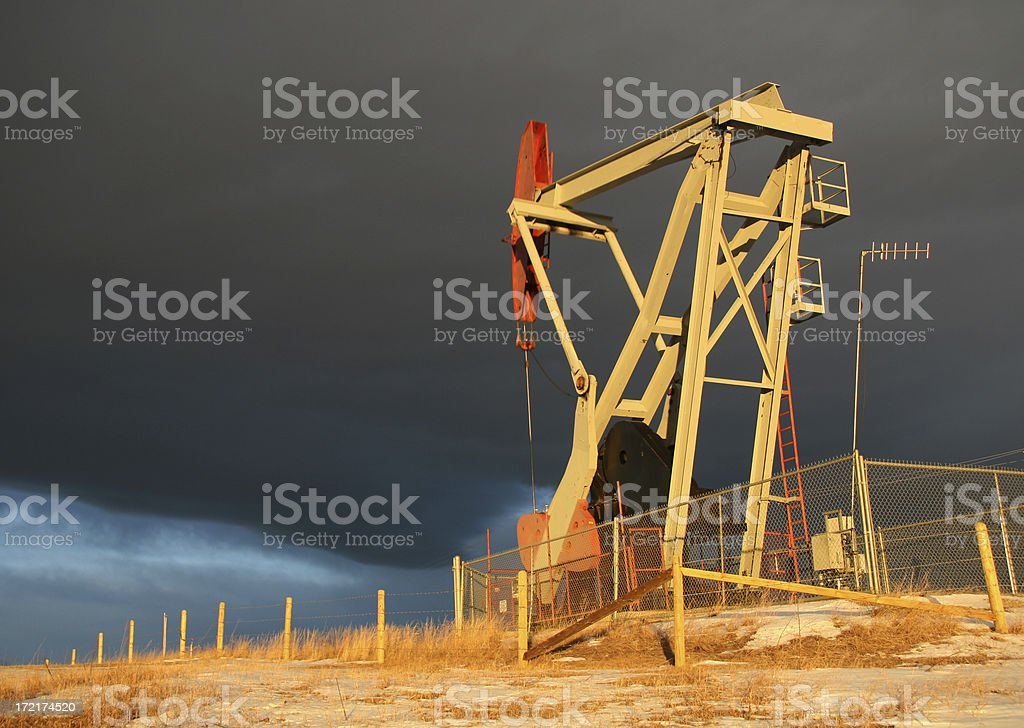 Pumpjack with Storm Clouds royalty-free stock photo