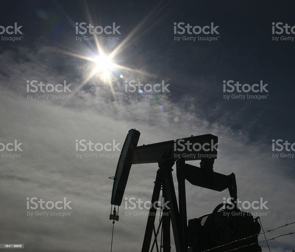 Pumpjack with Sun Flare royalty-free stock photo