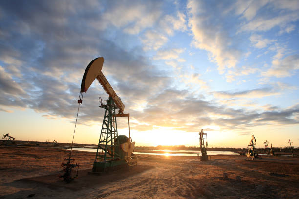 Pumpjacks, the sunset of Daqing oil field The Daqing Oil Field, formerly romanized as