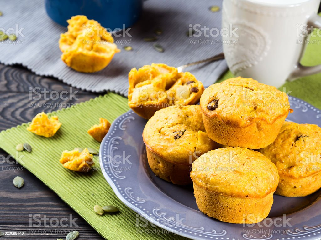 Pumpkin and apple muffins with raisins stock photo