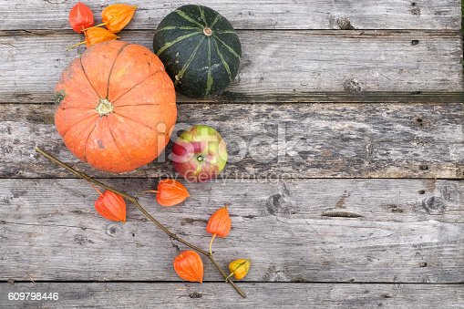 istock pumpkin and apple on wooden grey table 609798446