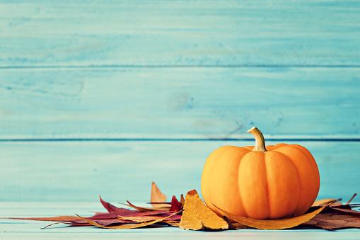Pumpkin and autumn leafs