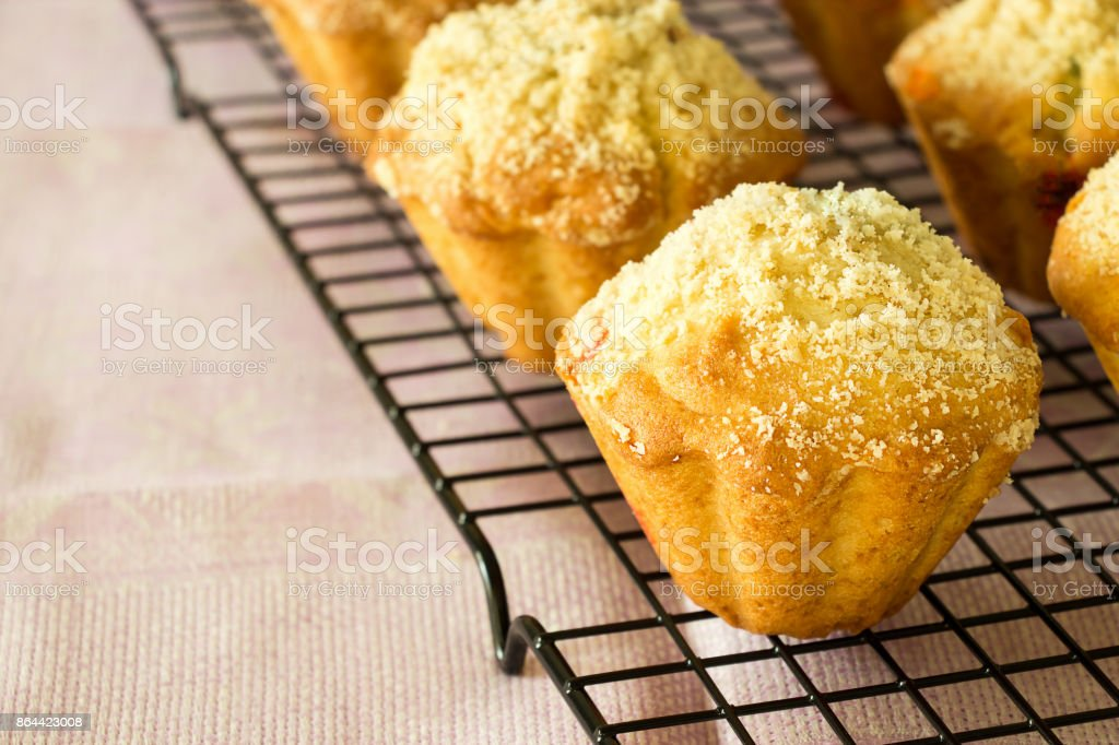 Pumpkin Apple Oats streusel Muffins on cooling rack. Selective focus. Copy space for your text. stock photo