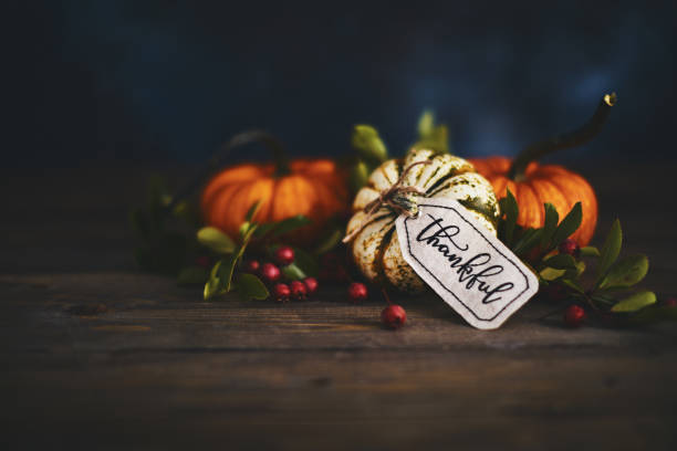 pumpkin assortment still life and thankful message - gift tag note stock photos and pictures