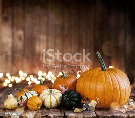 Autumn halloween beautiful pumpkin arrangement against an old wood background