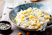 istock Pumpkin, blue cheese risotto in a ceramic plate 494226670