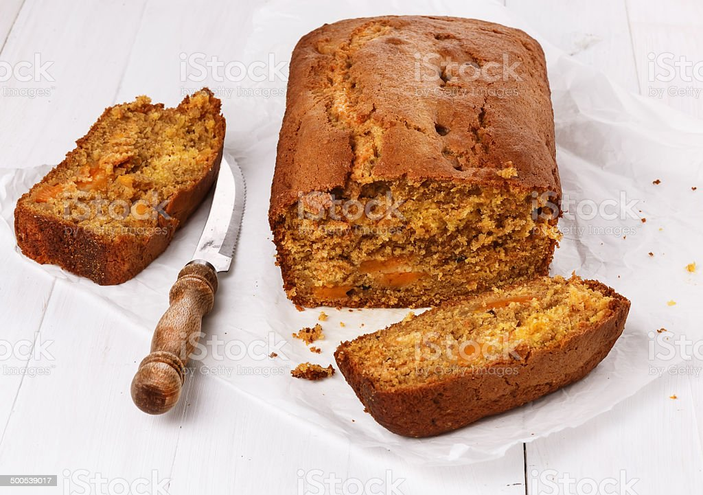Pumpkin bread loaf over white wooden background stock photo