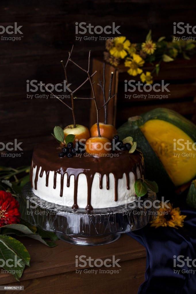 pumpkin cake with caramel apples stock photo