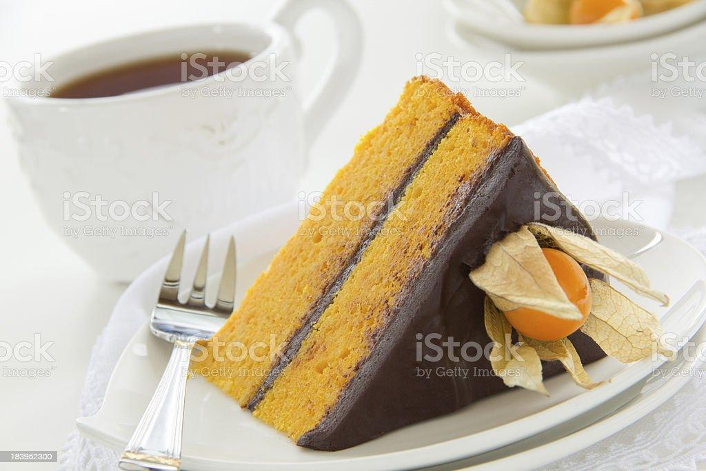 Pumpkin cake with chocolate cream. royalty-free stock photo