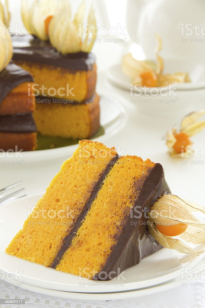 Pumpkin cake with chocolate cream. royalty-free stock photo