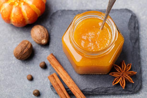 Pumpkin confiture, jam, sauce with spices Top view - foto de acervo