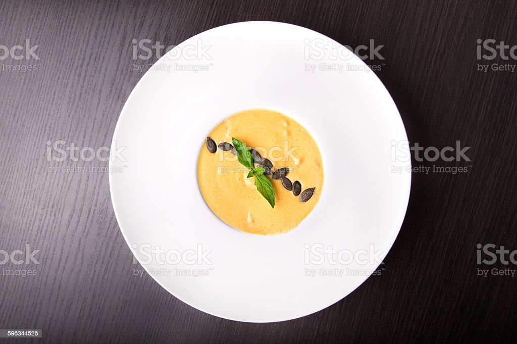 Pumpkin cream soup, top view royalty-free stock photo