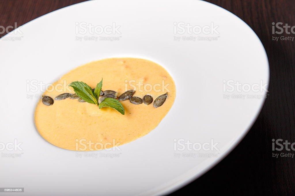 Pumpkin cream soup, top view royalty-free stock photo