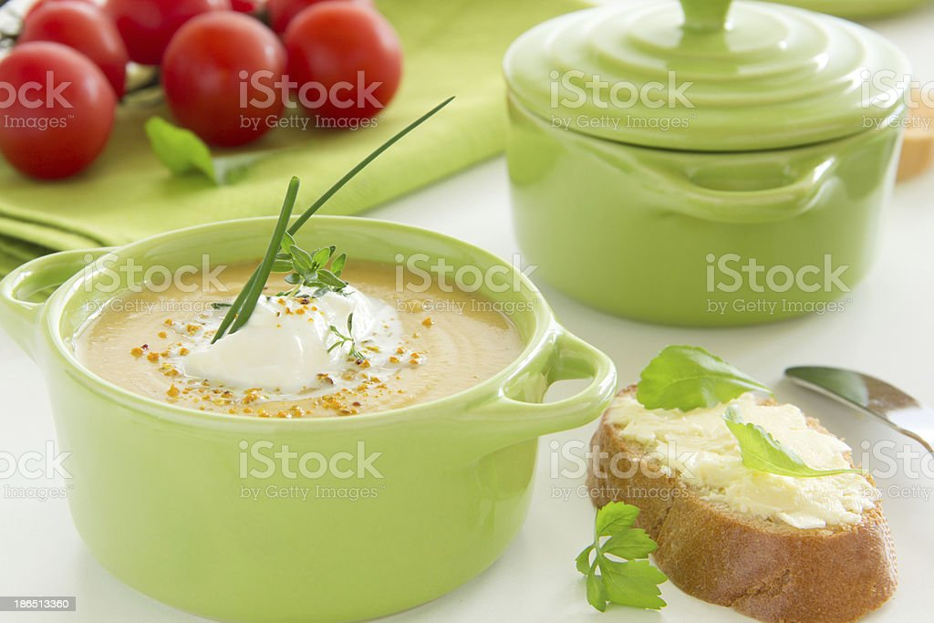 Pumpkin cream soup with thyme and cream. royalty-free stock photo