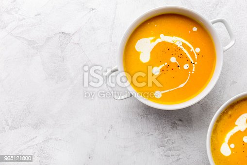 Pumpkin Creamy Soup Decorated With Fresh Cream Stock Photo & More Pictures of Appetizer
