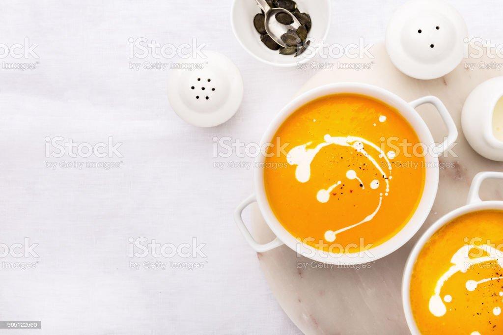 Pumpkin creamy soup decorated with fresh cream zbiór zdjęć royalty-free